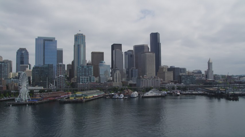 5K stock footage aerial video flying by the skyline and Seattle Great Wheel on Pier 57, Downtown Seattle, Washington Aerial Stock Footage | AX45_034