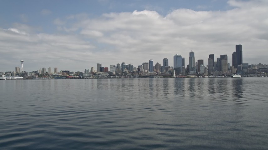 5K stock footage aerial video tilting up from Elliott Bay to reveal Downtown Seattle skyline, Washington Aerial Stock Footage AX45_039 | Axiom Images