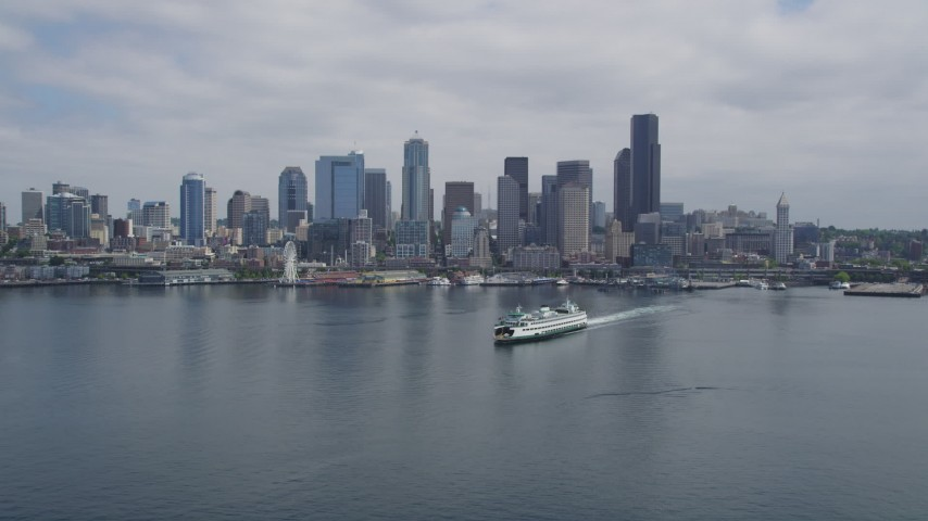 5K stock footage aerial video approaching a ferry sailing Elliott Bay near Downtown Seattle, Washington Aerial Stock Footage | AX45_041