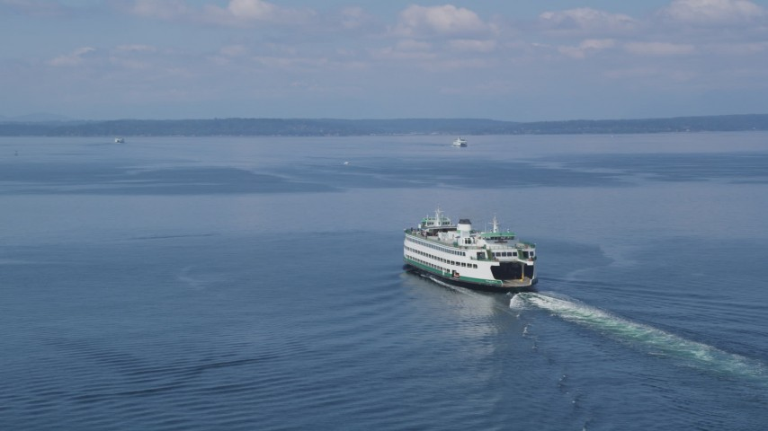 5K stock footage aerial video tracking a ferry as it sails Elliott Bay, Seattle, Washington Aerial Stock Footage | AX45_044
