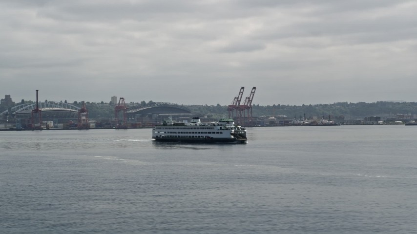 5K stock footage aerial video orbiting ferry sailing Elliott Bay, revealing Downtown Seattle skyline, Space Needle in the background, Washington Aerial Stock Footage | AX45_047