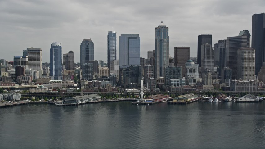 5K stock footage aerial video approaching the Seattle Aquarium, Great Wheel and Downtown Seattle skyline, Washington Aerial Stock Footage | AX45_048