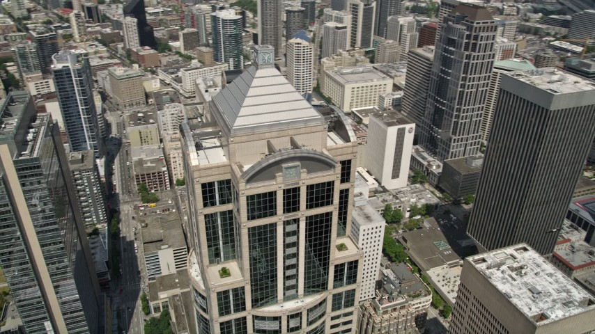 5K stock footage aerial video tilting to reveal and track 1201 Third Avenue Tower in Downtown Seattle, Washington Aerial Stock Footage | AX45_051