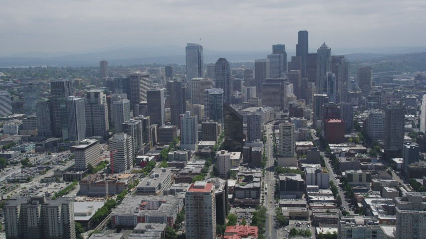 5K stock footage aerial video following 3rd Avenue to approach tall skyscrapers in Downtown Seattle, Washington Aerial Stock Footage | AX45_057