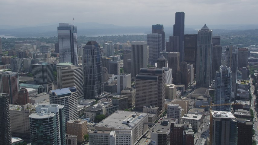 5K stock footage aerial video flying over high-rises to approach Columbia Center in Downtown Seattle, Washington Aerial Stock Footage | AX45_058