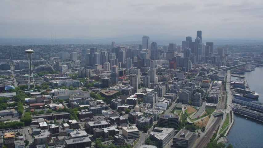 5K stock footage aerial video flying away from the Space Needle and skyscrapers in Downtown Seattle, Washington Aerial Stock Footage | AX45_070
