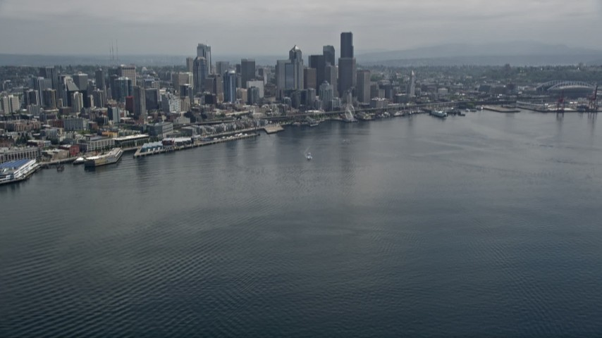 5K stock footage aerial video tilting from Elliott Bay to reveal the skyline of Downtown Seattle, Washington Aerial Stock Footage | AX45_071