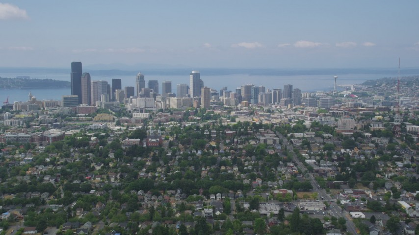 5K stock footage aerial video flying over neighborhoods approaching Downtown Seattle, Washington Aerial Stock Footage | AX45_083