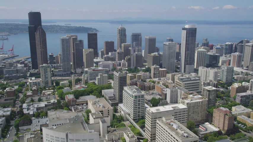 5K stock footage aerial video approaching Downtown Seattle high-rises and skyscrapers from the east side of the city, Washington Aerial Stock Footage | AX45_086