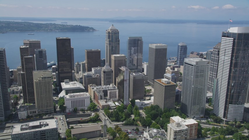 5K stock footage aerial video approaching skyscrapers, high-rises, and Elliott Bay, Downtown Seattle, Washington Aerial Stock Footage | AX45_087