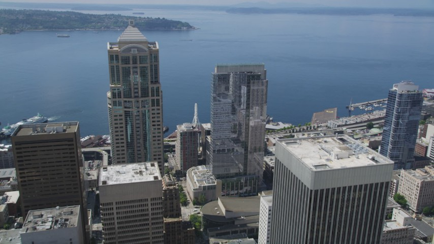 5K stock footage aerial video flying over Russell Investments Center, tilt to Seattle Great Wheel on Central Waterfront, Downtown Seattle, Washington Aerial Stock Footage | AX45_088