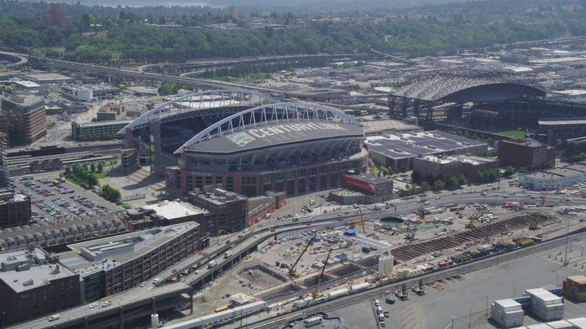 5K stock footage aerial video approaching CenturyLink Field beside Safeco Field, Downtown Seattle, Washington Aerial Stock Footage | AX45_090