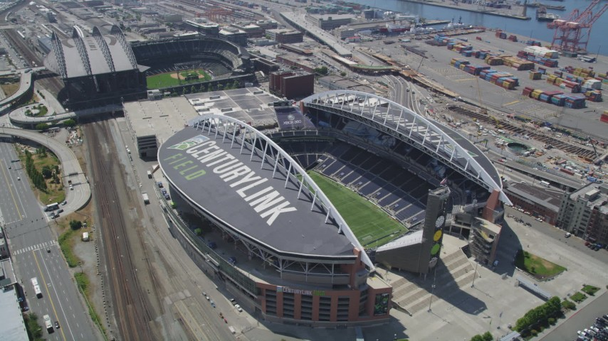 5K stock footage aerial video orbiting CenturyLink Field, with Safeco Field in the background, Downtown Seattle, Washington Aerial Stock Footage | AX45_092