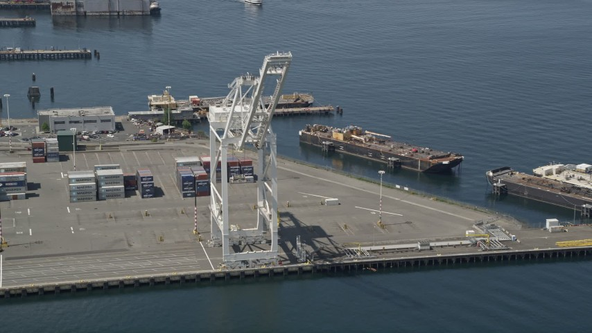 5K stock footage aerial video approaching a cargo crane near shipping containers, Port of Seattle, Washington Aerial Stock Footage | AX45_094
