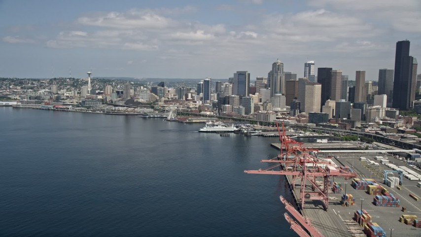 5K stock footage aerial video approaching the downtown skyline and Waterfront piers from the port, Downtown Seattle, Washington Aerial Stock Footage | AX45_095