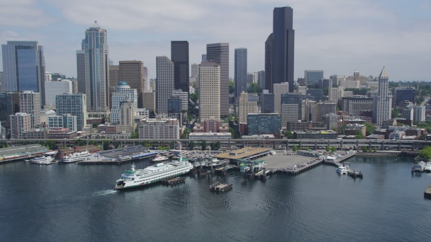 5K stock footage aerial video flying by downtown skyline, Seattle Ferry Terminal, reveal the Seattle Great Wheel and Seattle Aquarium, Downtown Seattle, Washington Aerial Stock Footage | AX45_096