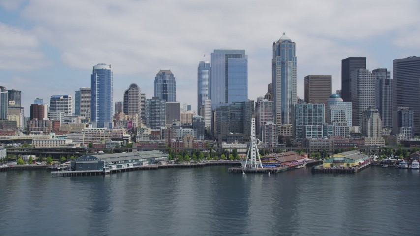 5K stock footage aerial video flying by Downtown Seattle skyline, Seattle Aquarium and Great Wheel, Downtown Seattle, Washington Aerial Stock Footage | AX45_097