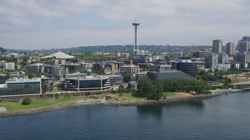 5K stock footage aerial video of modern waterfront office buildings and the Space Needle, Downtown Seattle, Washington Aerial Stock Footage | AX45_101