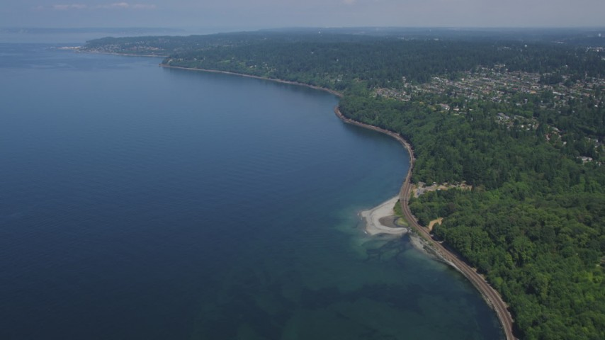 5K stock footage aerial video tilt from railroad tracks on the shore of Puget Sound, Blue Ridge, Washington Aerial Stock Footage | AX45_113