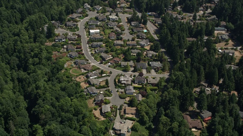 5K stock footage aerial video pass by a suburban neighborhood and trees, Lynnwood, Washington Aerial Stock Footage | AX45_129