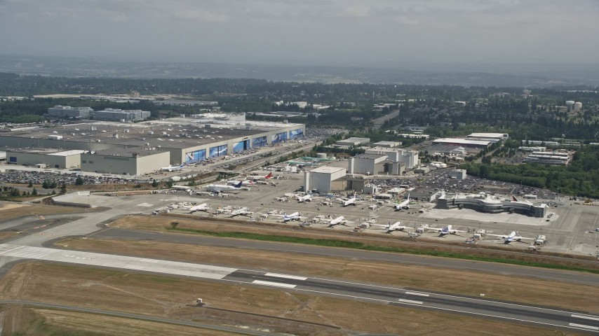 5K stock footage aerial video of airliners parked near the Boeing Factory at Paine Field airport, Everett, Washington Aerial Stock Footage | AX45_133