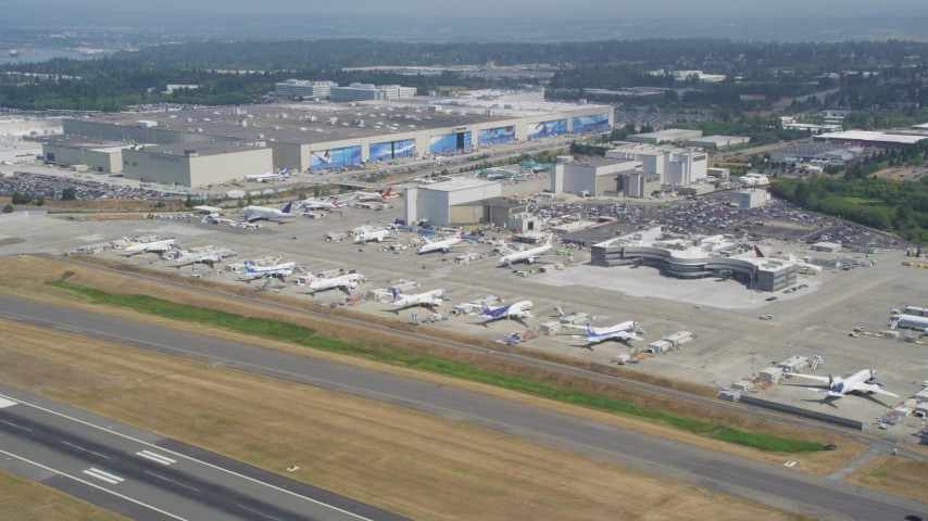 5K stock footage aerial video of Boeing Everett Factory and rows of airliners at Paine Field airport, Everett, Washington Aerial Stock Footage AX45_139 | Axiom Images