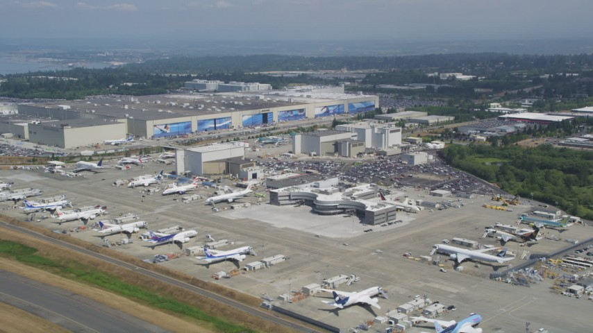 5K stock footage aerial video of Boeing Everett Factory and parked airliners, Paine Field, Washington Aerial Stock Footage | AX45_140