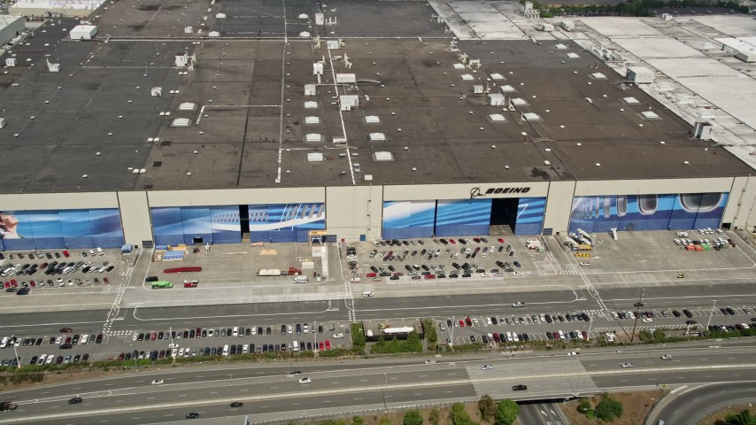 5K stock footage aerial video approach the Boeing Everett Factory and tilt to the roof, Paine Field, Everett, Washington Aerial Stock Footage AX45_144