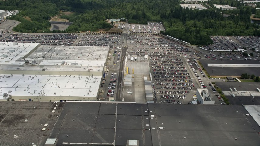 5K stock footage aerial video fly over Boeing Everett Factory to approach parking lots, Paine Field, Washington Aerial Stock Footage | AX45_145