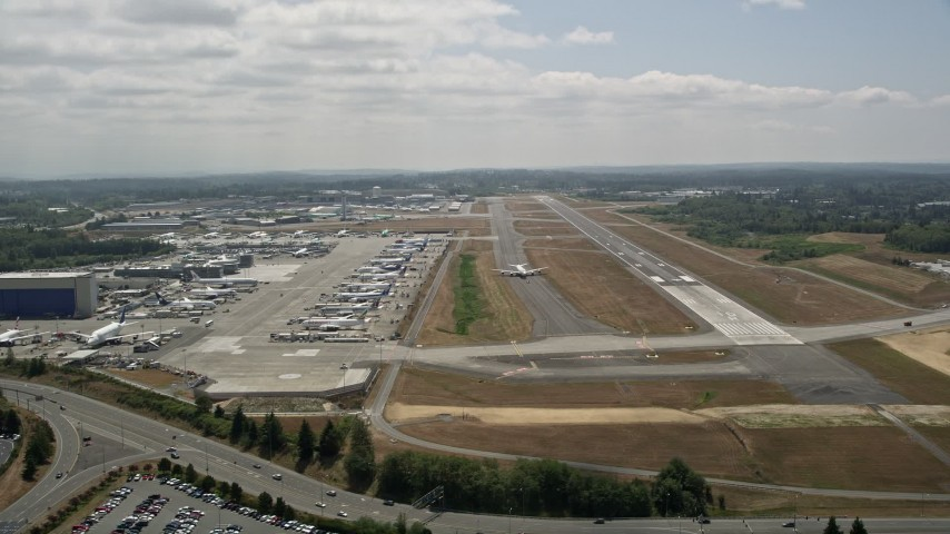 5K stock footage aerial video of a view of a 747 airliner on the runway at Paine Field, Washington Aerial Stock Footage | AX45_146