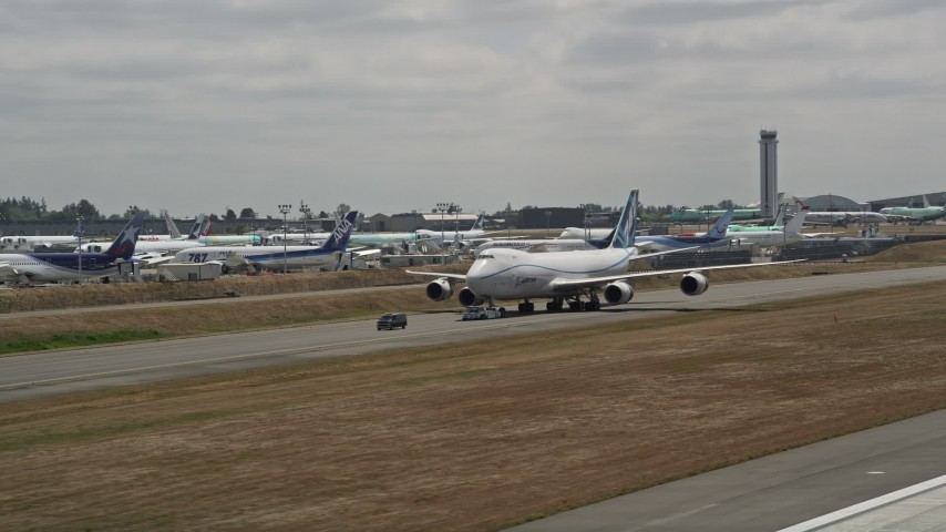 5K stock footage aerial video of tracking a 747 taxiing down a runway, Paine Field, Washington Aerial Stock Footage   AX45_147