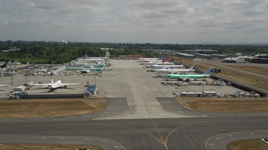 5K stock footage aerial video of rows of commercial airplanes parked at Paine Field, Washington Aerial Stock Footage | AX45_150