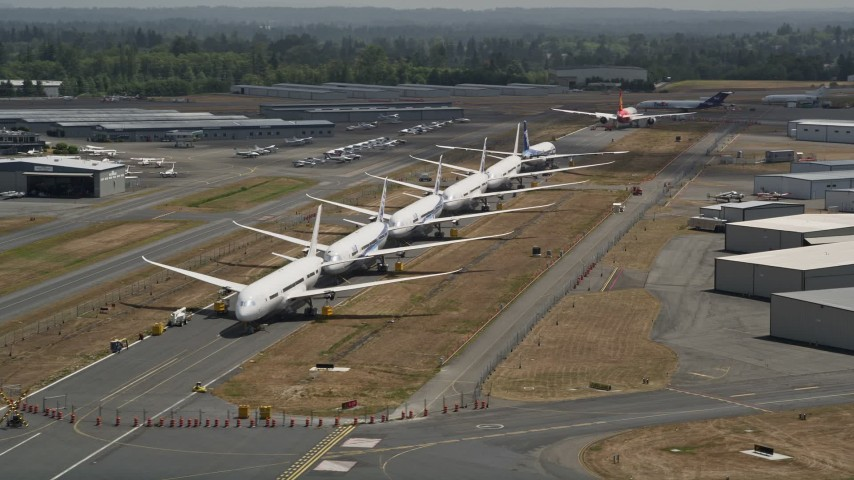 5K stock footage aerial video flyby six commercial airliners in a row at Paine Field, Washington Aerial Stock Footage | AX45_151