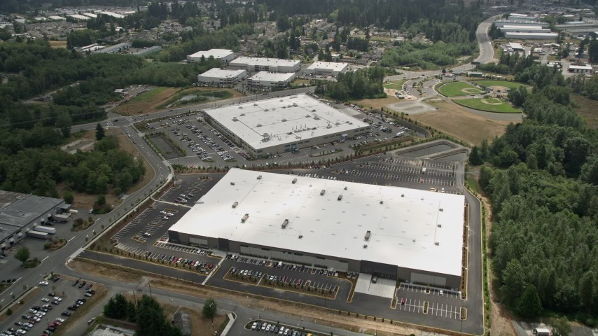5K stock footage aerial video fly over a pair of large warehouse buildings in Lynnwood, Seattle, Washington Aerial Stock Footage | AX46_004