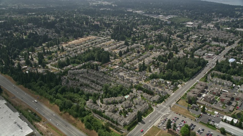 5K stock footage aerial video of flying by condominiums in Lynnwood, Washington Aerial Stock Footage | AX46_008