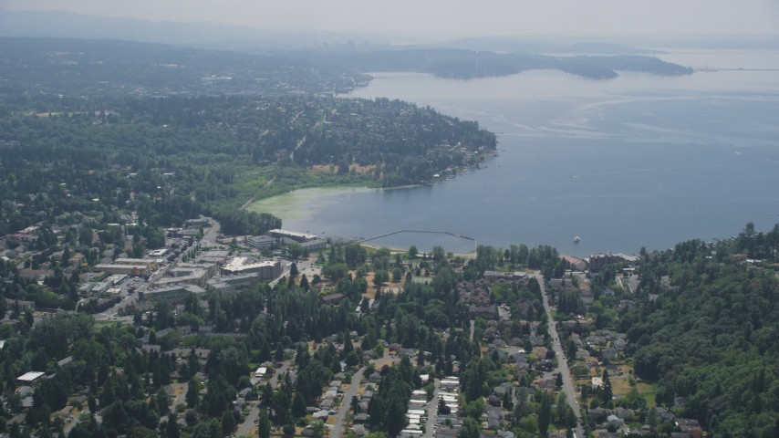 5K stock footage aerial video flying by apartment complexes and suburban homes by the shore of Lake Washington, Kirkland, Washington Aerial Stock Footage | AX46_021