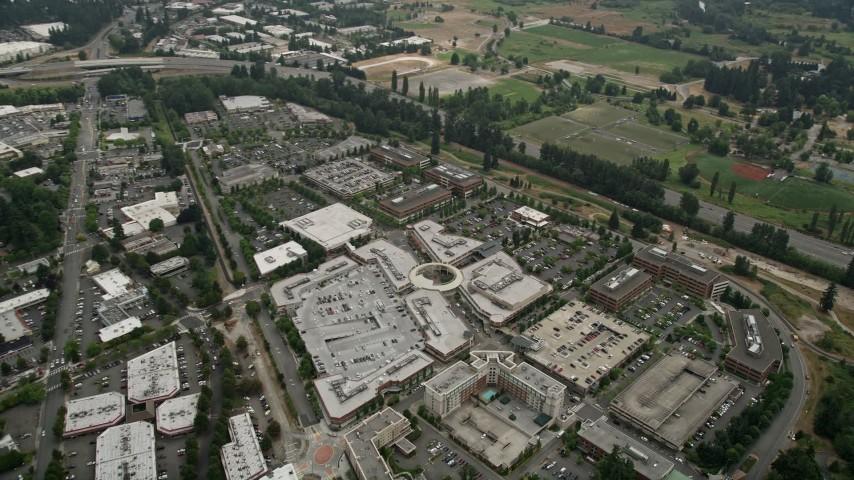 5K stock footage aerial video tilting to a bird's eye view of Redmond Town  Center shopping mall, Redmond, Washington