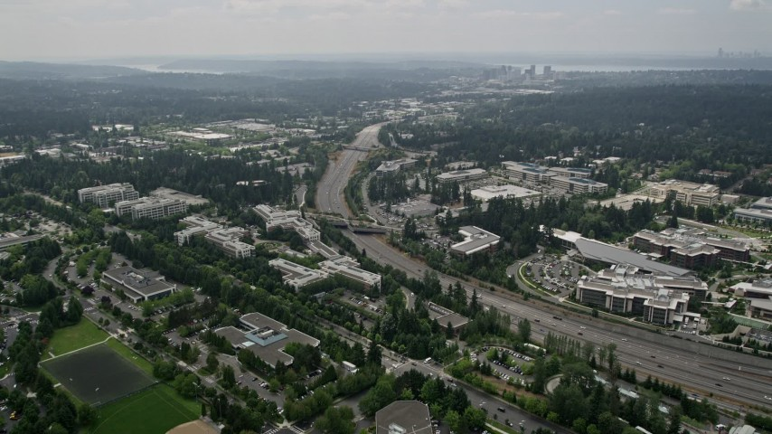 5K stock footage aerial video of State Route 520 and office buildings at Microsoft Headquarters, Redmond, Washington Aerial Stock Footage | AX46_036