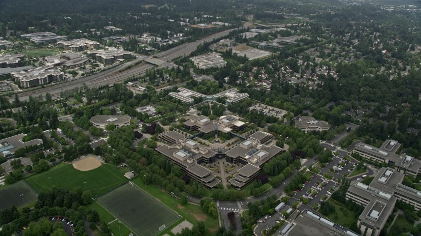 5K stock footage aerial video reverse view of office buildings at the Microsoft Headquarters campus, Redmond, Washington Aerial Stock Footage | AX46_037