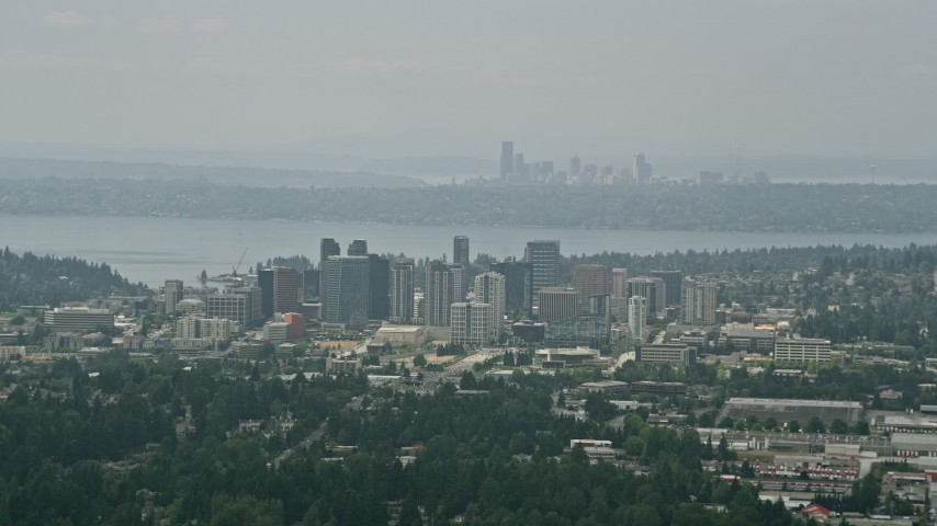 5K stock footage aerial video of skyscrapers in Downtown Bellevue, Seattle skyline in the far distance, Washington Aerial Stock Footage | AX46_039