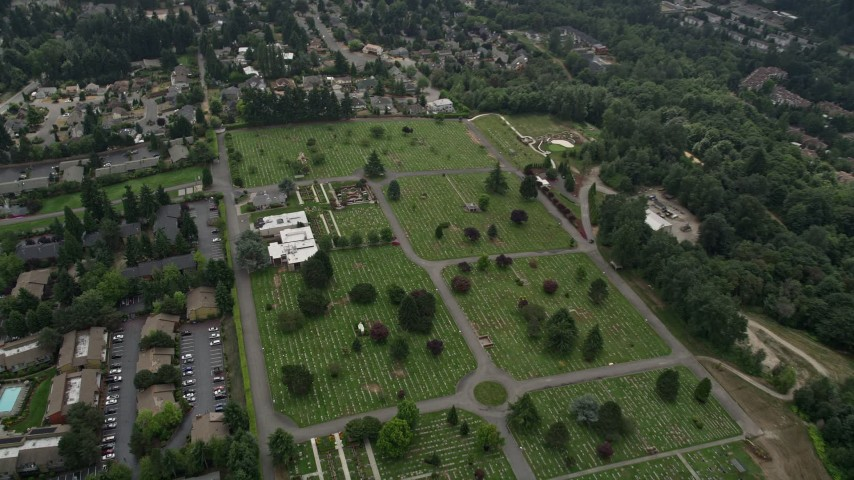 5K aerial video tilting to a bird's eye view of a cemetery and funeral home,  Bellevue, Washington Aerial Stock Footage | AX46_042