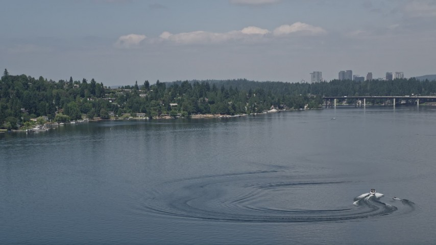 5K stock footage aerial video of tracking a speedboat pulling a raft on Lake Washington, Washington Aerial Stock Footage | AX46_046
