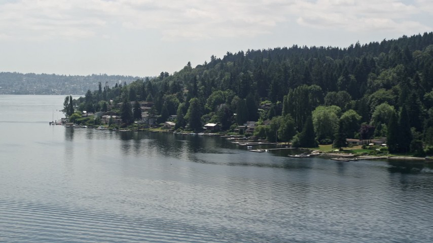 5K stock footage aerial video of flying by lakeside homes with docks on Lake Washington, Mercer Island, Washington Aerial Stock Footage | AX46_047