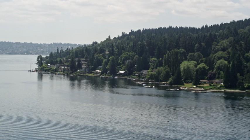 5K aerial video of flying by lakeside homes with docks on Lake Washington, Mercer Island, Washington Aerial Stock Footage | AX46_047