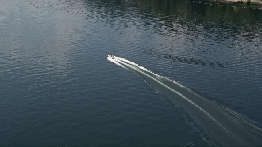 5K stock footage aerial video track a speedboat pulling a raft on Lake Washington, Washington Aerial Stock Footage | AX46_049