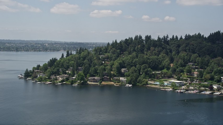 5K aerial video of lakeside homes with small docks on Mercer Island, Washington Aerial Stock Footage | AX46_050