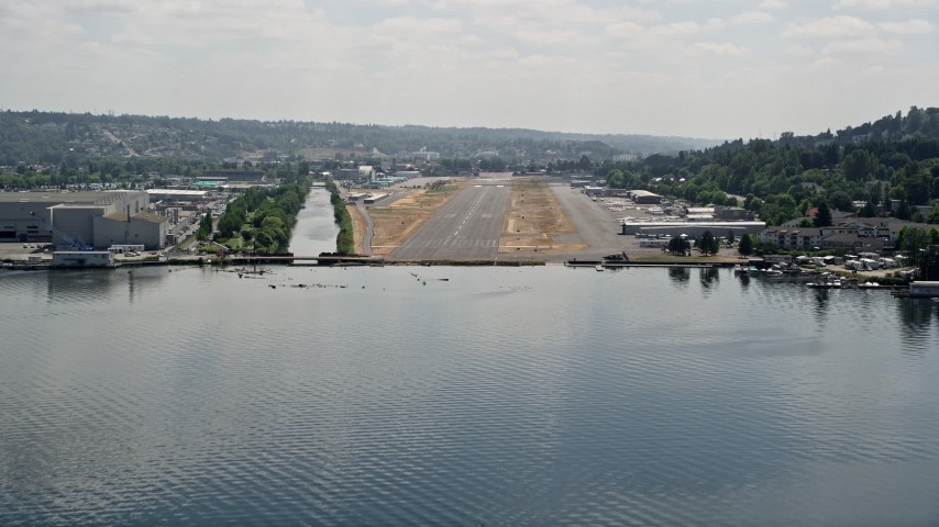 5K stock footage aerial video of approaching Renton Municipal Airport runway from Lake Washington, Washington Aerial Stock Footage | AX46_052