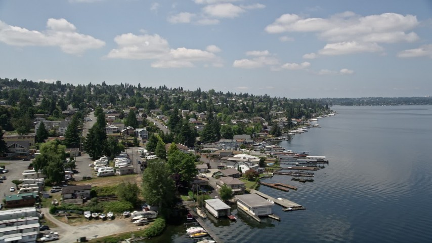 5K aerial video fly by lakeside homes with docks on Lake Washington, Renton, Washington Aerial Stock Footage | AX46_053