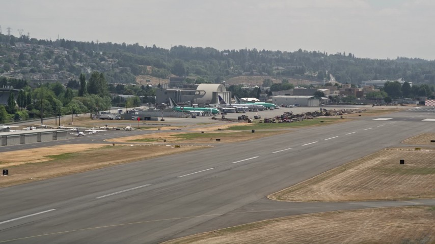 5K stock footage aerial video of airliners parked at a small airport, Renton Municipal Airport, Washington Aerial Stock Footage | AX46_054