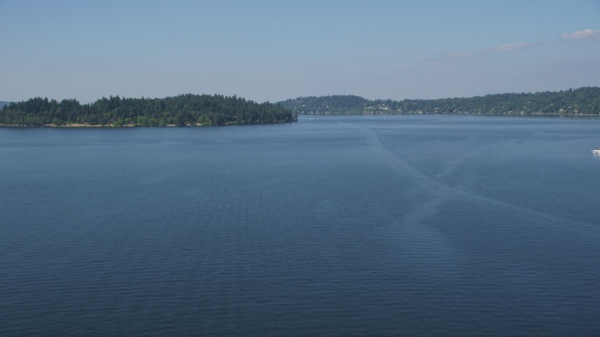 5K stock footage aerial video fly over Lake Washington to approach Mercer Island, Washington Aerial Stock Footage | AX47_003
